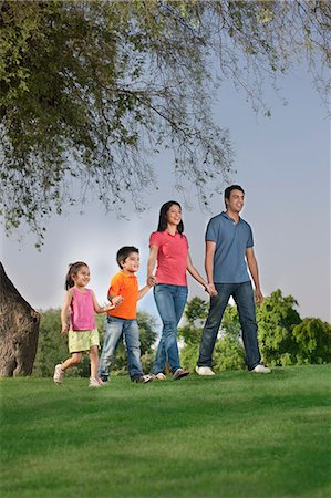 east indian mother and children - Family walking in a park Stock Photo - Premium Royalty-Free, Code: 614-05955377