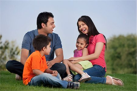 pregnant asian - Family having fun in a park Stock Photo - Premium Royalty-Free, Code: 614-05955379