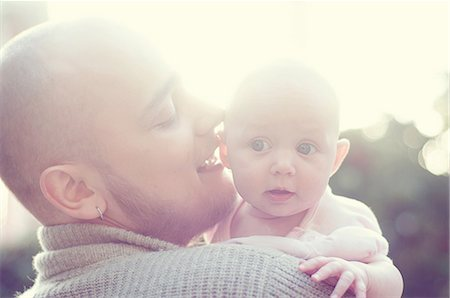 Father whispering to baby Stock Photo - Premium Royalty-Free, Code: 614-05955386