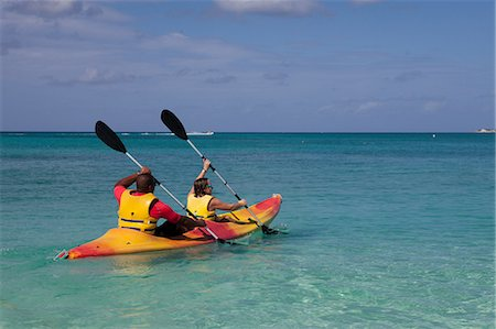extremism - Two people kayaking in Caribbean sea, Grand Cayman, Cayman Islands Stock Photo - Premium Royalty-Free, Code: 614-05955468