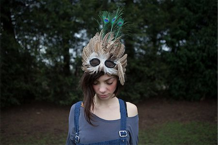 quirky - Young woman with feathered mask on her head Stock Photo - Premium Royalty-Free, Code: 614-05955477