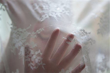 dreamy - Hand of woman behind lace curtain Stock Photo - Premium Royalty-Free, Code: 614-05955489