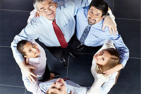 Colleagues with arms around each other Stock Photo - Premium Royalty-Free, Code: 614-05955533