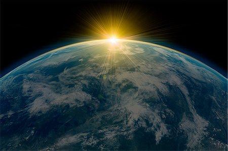 Sunrise over planet earth Stock Photo - Premium Royalty-Free, Code: 614-05955544
