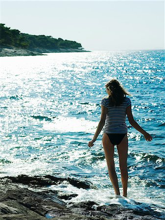 Young woman walking in sea, Dubrovnik, Croatia Stock Photo - Premium Royalty-Free, Code: 614-05955568