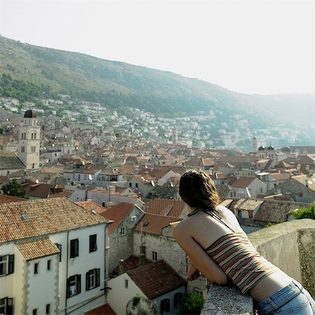 Young woman overlooking Dubrovnik, Croatia Stock Photo - Premium Royalty-Free, Code: 614-05955572