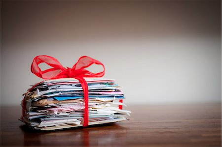 Stack of letters tied together with ribbon Stock Photo - Premium Royalty-Free, Code: 614-05955600