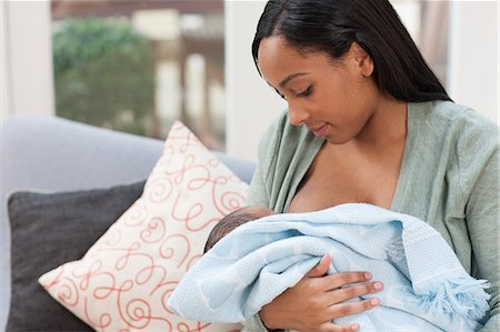 Young woman holding baby son in blanket Stock Photo - Premium Royalty-Free, Code: 614-05955652
