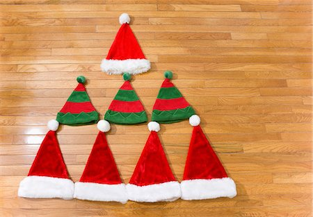 decoration - Christmas hats in shape of christmas tree Stock Photo - Premium Royalty-Free, Code: 614-05955785