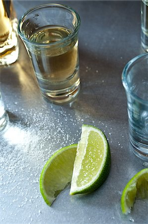 Tequila shots with lime wedges Stock Photo - Premium Royalty-Free, Code: 614-06002067