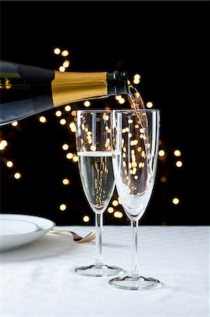Pouring glasses of champagne Stock Photo - Premium Royalty-Free, Code: 614-06002069