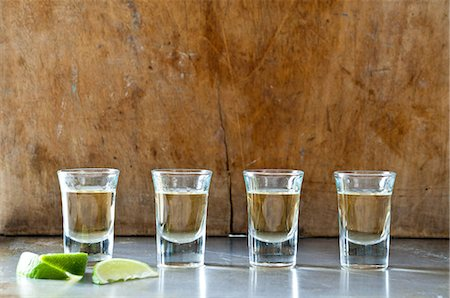 Row of tequila shots Stock Photo - Premium Royalty-Free, Code: 614-06002075