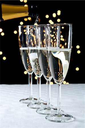 Pouring glasses of champagne Stock Photo - Premium Royalty-Free, Code: 614-06002083