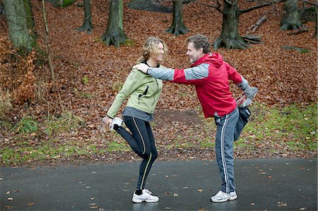 Mature couple leaning together to perform warming up exercises Stock Photo - Premium Royalty-Free, Code: 614-06002107