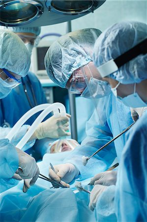 Team of surgeons during operation Stock Photo - Premium Royalty-Free, Code: 614-06002157