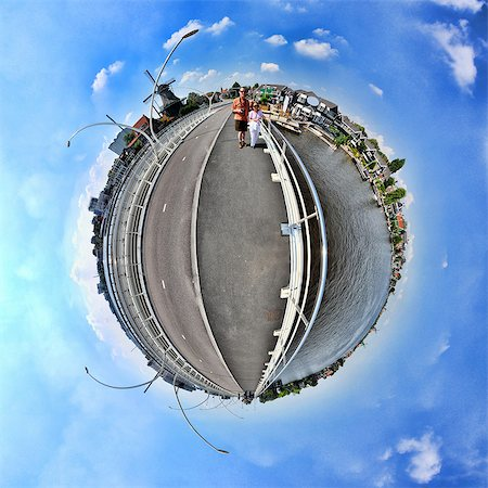 small - A couple in Zaanse Schans, Netherlands, little planet effect Stock Photo - Premium Royalty-Free, Code: 614-06002161