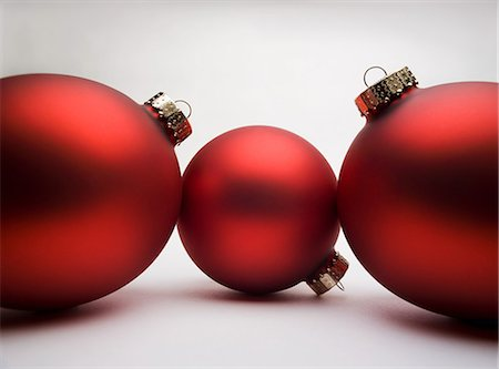Red Christmas decorations, studio shot Stock Photo - Premium Royalty-Free, Code: 614-06002238