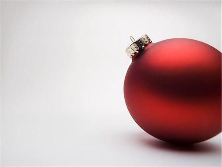 Red Christmas decoration, studio shot Stock Photo - Premium Royalty-Free, Code: 614-06002239