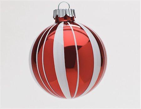 Red and white Christmas bauble, studio shot Stock Photo - Premium Royalty-Free, Code: 614-06002245