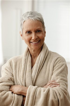 Senior woman in bathrobe, smiling Stock Photo - Premium Royalty-Free, Code: 614-06002265