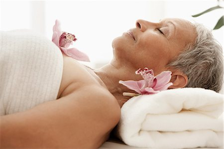 Senior woman relaxing on massage table Stock Photo - Premium Royalty-Free, Code: 614-06002274