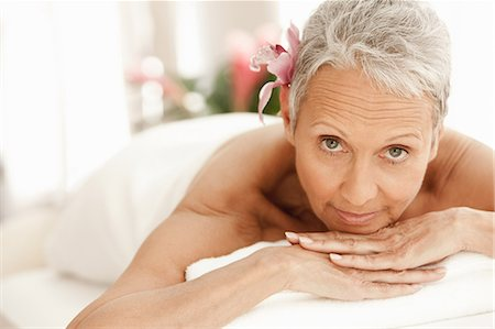 Senior woman relaxing on massage table, portrait Stock Photo - Premium Royalty-Free, Code: 614-06002275