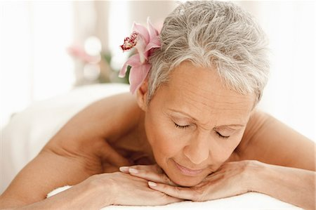 Senior woman relaxing on massage table Stock Photo - Premium Royalty-Free, Code: 614-06002276