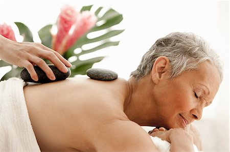 Senior woman receiving stone therapy Stock Photo - Premium Royalty-Free, Code: 614-06002278