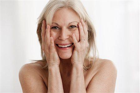 Mature woman laughing, portrait Stock Photo - Premium Royalty-Free, Code: 614-06002294