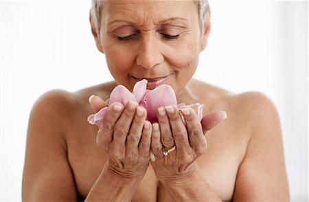 Senior woman holding flower Stock Photo - Premium Royalty-Free, Code: 614-06002297