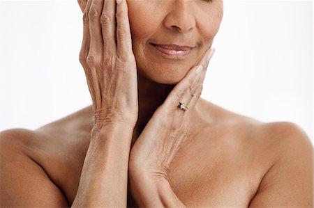 Senior woman against white background Stock Photo - Premium Royalty-Free, Code: 614-06002299