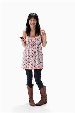 Smiling mature woman holding cellphone, studio shot Stock Photo - Premium Royalty-Free, Code: 614-06002354