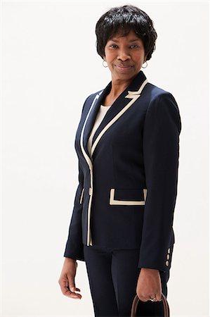 Portrait of mature African American businesswoman, studio shot Stock Photo - Premium Royalty-Free, Code: 614-06002399
