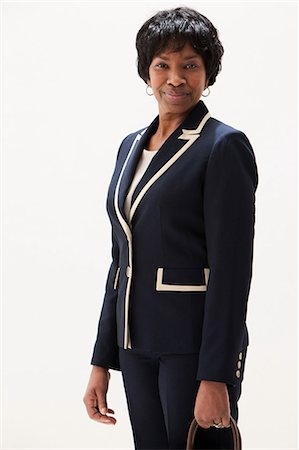 Portrait of mature African American businesswoman, studio shot Stock Photo - Premium Royalty-Free, Code: 614-06002399