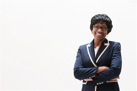 Portrait of mature African American businesswoman, studio shot Stock Photo - Premium Royalty-Free, Code: 614-06002406