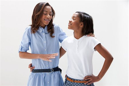 African American sisters standing together, studio shot Stock Photo - Premium Royalty-Free, Code: 614-06002417