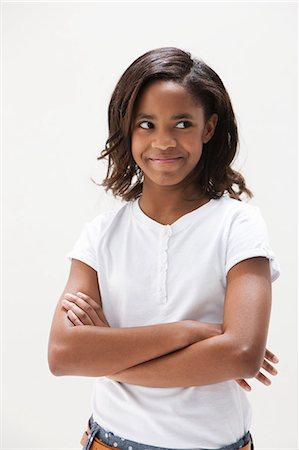African American girl looking away, studio shot Stock Photo - Premium Royalty-Free, Code: 614-06002411