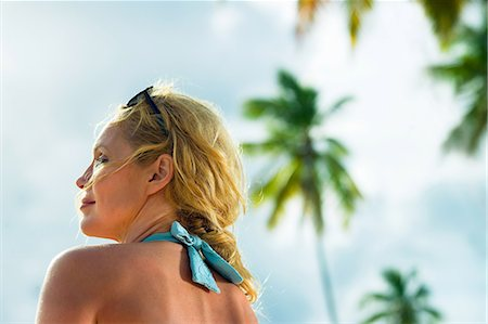 Head and shoulders of woman on vacation Stock Photo - Premium Royalty-Free, Code: 614-06002597