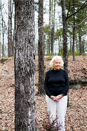 Portrait of senior woman in forest, hands clasped Stock Photo - Premium Royalty-Free, Code: 614-06044099