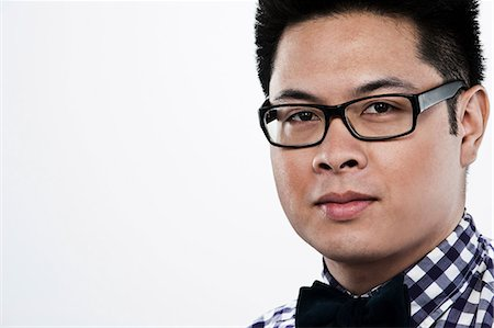 filipino (male) - Portrait of young man against white background Stock Photo - Premium Royalty-Free, Code: 614-06044091
