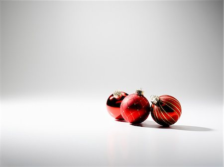 Three baubles, studio shot Stock Photo - Premium Royalty-Free, Code: 614-06044145
