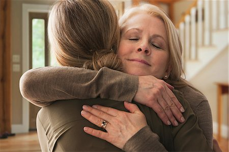 daughter middle-aged mother women young adults - Mother embracing adult daughter Stock Photo - Premium Royalty-Free, Code: 614-06044367