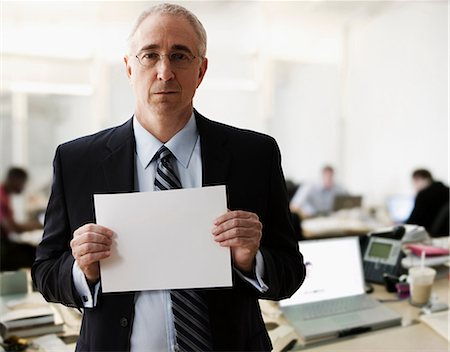 sign - Portrait of senior man holding blank sheet of paper Stock Photo - Premium Royalty-Free, Code: 614-06044396