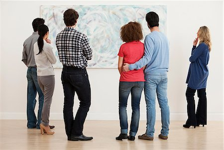Men and women looking at oil painting in art gallery Stock Photo - Premium Royalty-Free, Code: 614-06044460
