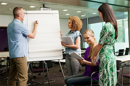 Office colleagues in whiteboard meeting in office Stock Photo - Premium Royalty-Free, Code: 614-06044501