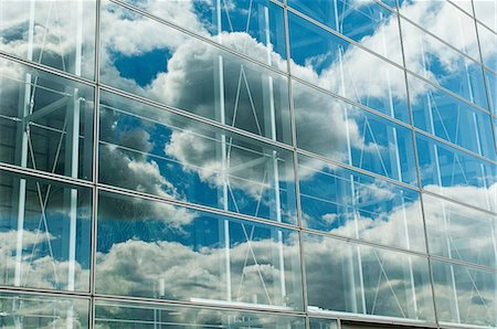 Cloudy blue sky reflected in office windows Stock Photo - Premium Royalty-Free, Code: 614-06044730