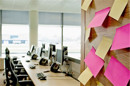self adhesive note - Sticky notes on wall in empty office Stock Photo - Premium Royalty-Free, Code: 614-06044732
