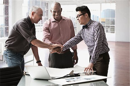 filipino (male) - Businessmen shaking hands in office Stock Photo - Premium Royalty-Free, Code: 614-06043786