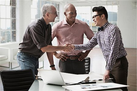 southeast asian ethnicity - Businessmen shaking hands in office Stock Photo - Premium Royalty-Free, Code: 614-06043787
