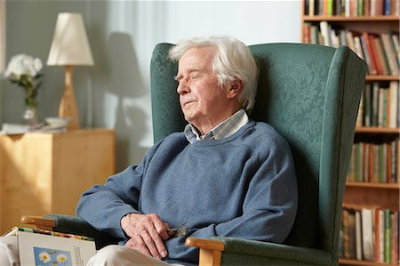 Senior man sleeping in armchair Stock Photo - Premium Royalty-Free, Code: 614-06043867